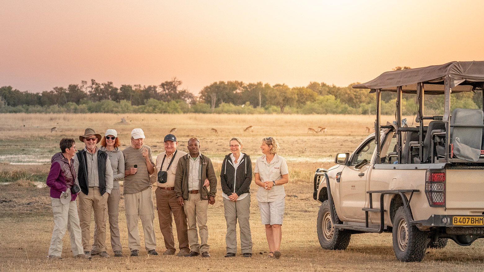 Guests on their Botswana Safari overlooking the wide flood plains of Khwai.