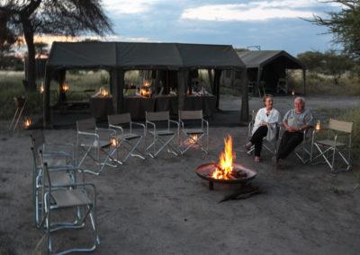 "Guests sitting on a bonfire in the mobile Safari Camp ""O Bona Explorer"""
